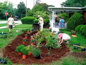 Homeowners planting a rain garden